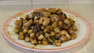 SmokingPit.com - Cajun Shrimp & Bay Scallops with a cajun butter sauce and mushrooms. Griddle cooked on a Yoder YS640 Pellet grill. The meat. Cajun butter sauce. Cookied on the Yoder YS640 smoker & Traeger texas grill.