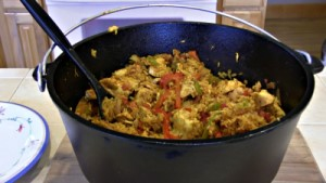 "SmokingPit.com - Dutch oven Arroz Con Pollo cooked in a Lodge 12"" dutch oven in my Scottsdale Santa Maria style cooker. The Money Shot."
