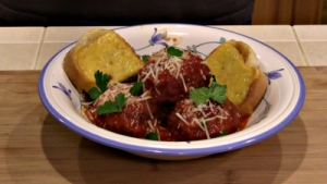 SmokingPit.com - Apple Wood Smoked Italian Meatballs in an authentic San Marzano Tomato Sauce. Smoked on a Yoder YS640. -  The money shot!