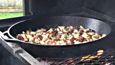BBQ off the Scottsdale by Arizona BBQ Outfitters. This is a Santa Maria style cooker with a lid that accepts a Cast iron skillet, Cast iron Wok and a cast Iron Griddle. Garlic Red potatoes cooked on the Lodge cast iron skillet on the Scottsdale.