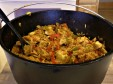 Smokingpit.com - Dutch Oven cooked Arroz Con Polo cooked on the Scottsdale Santa Maria style wood grill by Arizona BBQ Outfitters.