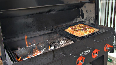 SmokingPit.com - BBQ Chicken & Bacon Pizza recipe wood fire cooked on my Scottsdale Santa Maria style cooker. Coming off the cooker.