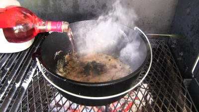 "SmokingPit.com - Dutch oven Swiss Steak cooked in a Lodge 12"" dutch oven in my Scottsdale Santa Maria style cooker. De-glazing the Dutch Oven with red wine."