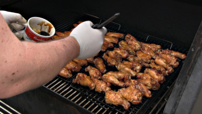 SmokingPit.com - Sesame Soy Chicken Wings.  Slow cooked on the yoder YS640. - Mopping the wings.