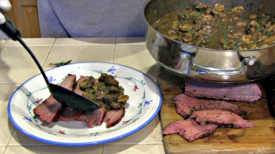 SmokigPit.com - Beef Tri Tip Marsala Recipe - slow cooked on a Yoder YS640 Pellet smoker. - Applying marsala sauce to the Tri Tip roast.